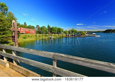 Rustic wooden trestle across the Bearskin State Trail in Minocqua Wisconsin.