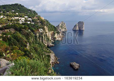 Aerial View Of Capri's Faraglioni, Big Cliffs Emerging From The Sea.