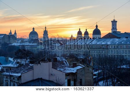 Morning Lviv sunrise. View of the central part of the city and churches: St. Michael's Ukrainian Catholic Church Church of the Holy Communion Korniakt Tower Armenian cathedral Transfiguration Church Lviv city council.