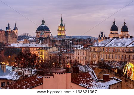 Evening Lviv. View of the central part of the city and churches: St. Michael's Ukrainian Catholic Church Church of the Holy Communion Korniakt Tower Armenian cathedral Transfiguration Church.