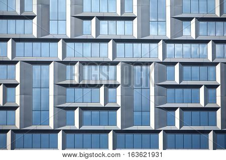 Wall of modern office building of glass and metal in techno style as abstract  texture
