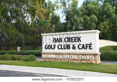 IRVINE CALIFORNIA - JANUARY 1 2017: Oak Creek Golf Club sign. The Tom Fazio designed course includes a golf school pro shop and facilities for events and weddings.