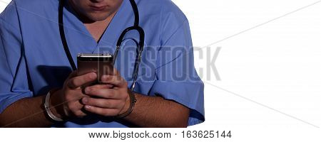 Medical Professional in Handcuffs Using a Cell Phone