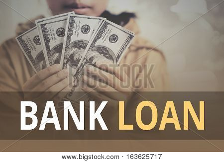 Bank Loan Word Over Young Girl Holding Dollar Bills.