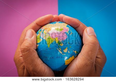 hands holding the world, globe. concept for protecting the world