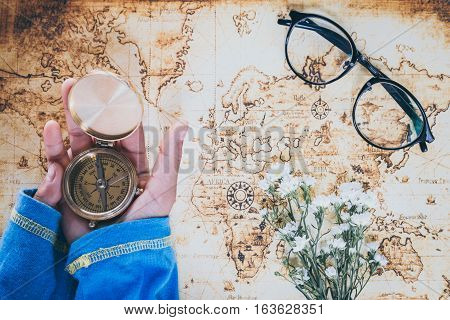 Overhead view of Traveler's accessories, Essential vacation items, Travel concept background, vintage background, love story, selective focus, save money to see the world