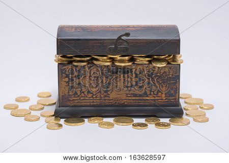 Chocolate coins stuffed into a small wooden chest