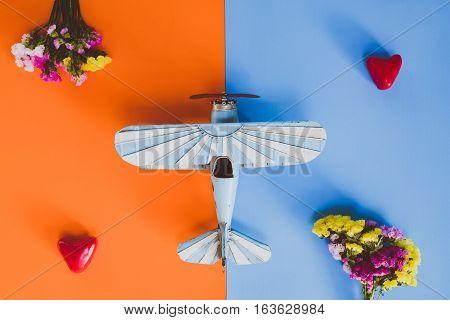 old vintage toy planes on orange and blue background