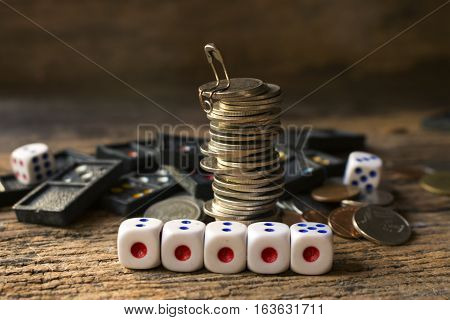 stack of coins with diceconcept idea for business.