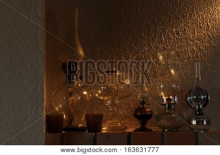 Oil lamps. Ornament on the mantelpiece. Light source. The Middle Ages.