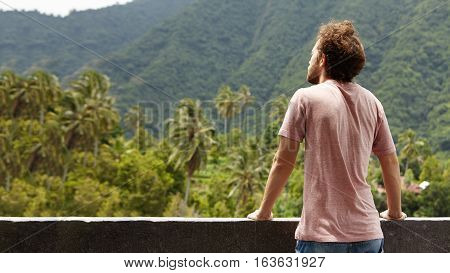 Back View Of Bearded Traveler Man Contemplating Beauties Of Green Woods While Spending Vacations In