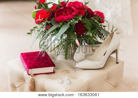 Wedding rings with roses on red beutiful book