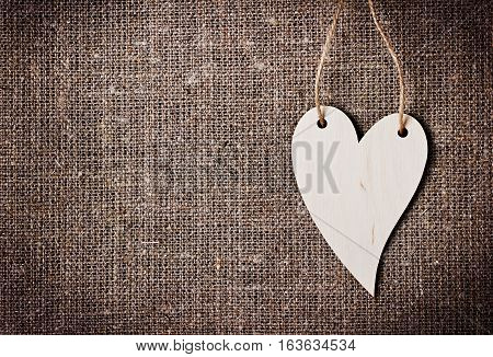 Valentines day card with heart on a sacking, hessian or burlap background. Love message concept.