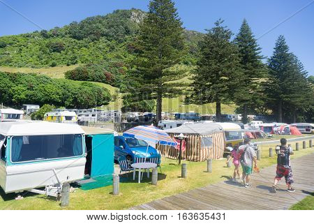 Tauranga New Zealand, December 20, 2016; Summer holidays, Kiwi-style at Mount Maunganui old -style caravans along the Mount Camping Ground beach-front sites