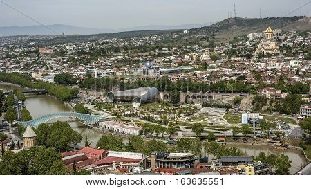 Georgia Tbilisi. View from Narikala fortress of the Old Town the river Kura Peace Bridge the Presidential Palace the Cathedral of Holy Trinity Cathedral of Tbilisi .