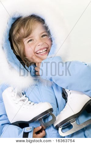 Happy girl with figure skates