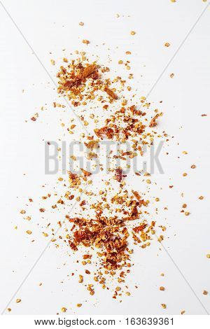 Red Hot Chili Pepper's Flakes. White Background. Isolated.