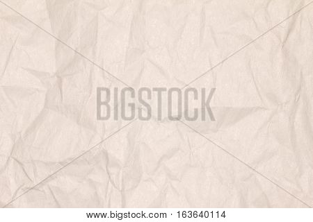 Recycled crumpled light brown paper texture or paper background for design with copy space for text or image.