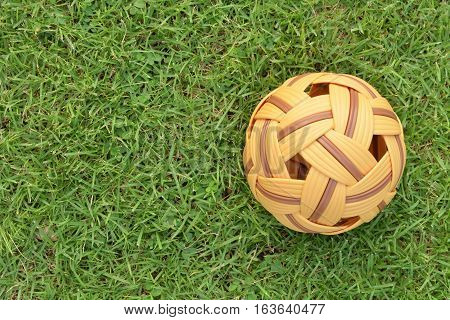 Rattan ball on the lawn with copy space for text,outdoor activities.