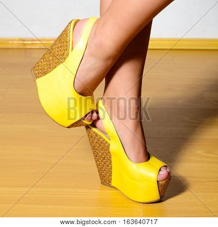 Beautiful Female Legs In Yellow Shoes With High Platform