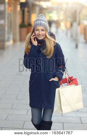 Trendy Young Woman Shopper Using Her Mobile