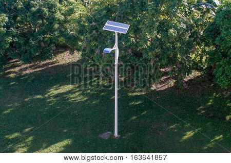 Street lamp powered by solar power.Solar street lights are raised light sources which are powered by photovoltaic panels generally mounted on the lighting structure or integrated in the pole itself.