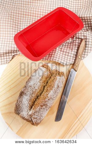 home baked irish soda bread with bread knife on a wooden board