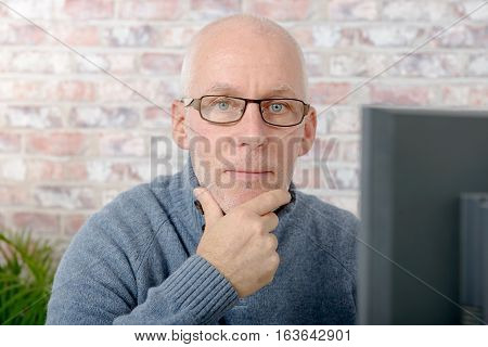 Portrait of a handsome mature man using computer at office