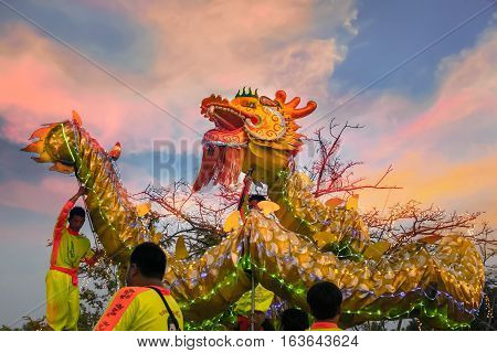 BANGKOK, THAILAND - FEBRUARY 20 2016: Unidentified group of people perform a traditional dragon dance at Rama IX public park to celebrate traditional Chinese's lunar new year