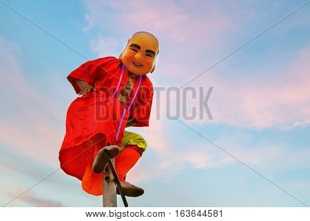 BANGKOK, THAILAND - FEBRUARY 20 2015:  Unidentified Chinese clown appears in a traditional lion dance at Rama IX public park to celebrate traditional Chinese's lunar new year