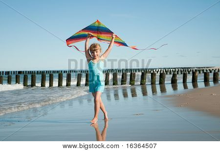 Little girl playing with kite