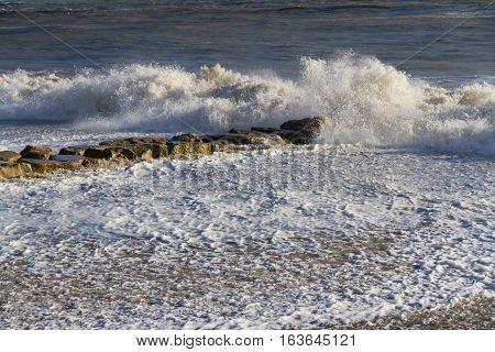 Waves on sandy beach. Mudeford Christchurch England United Kingdom.