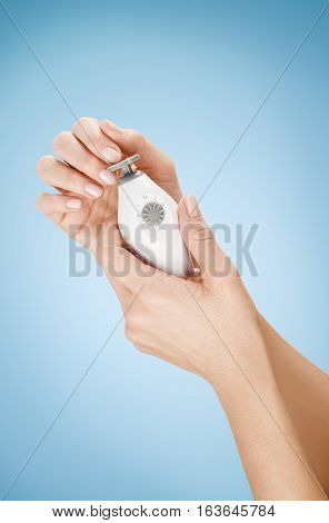 Woman's manicure concept for advertising. Background with beautiful manicured female hands and nails. Skin, body care or spa treatment concept with natural nail manicure