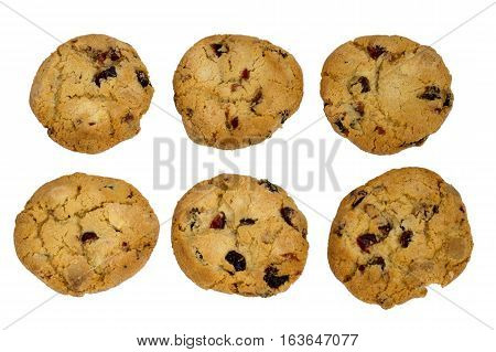 Six cookies with raisins isolated over white background top view