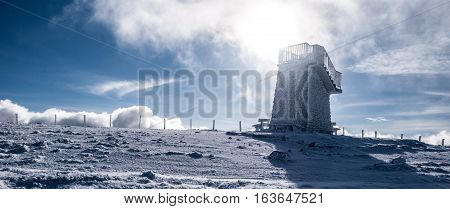 stony view tower covered by ice on Pretulalpe hill in winter Fischbacher Alpen mountains in Styria