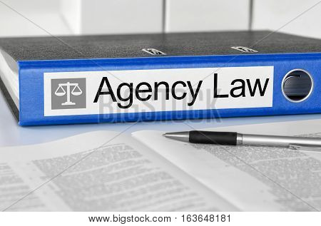 Blue Folder With The Label Agency Law