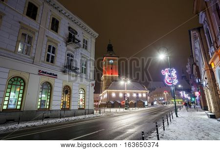 BRASOV, ROMANIA, - 15 DECEMBER, 2016: Brasov Council House night view decorated for Christmas and traditional winter market in the old town center Romania