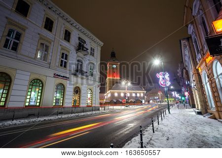 BRASOV ROMANIA - 15 DECEMBER 2016: Brasov Council House night view decorated for Christmas and traditional winter market in the old town center Romania