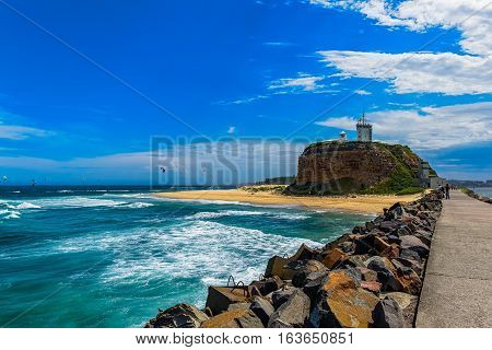 Nobby Beach in Newcastle NSW Australia.The first beach on the Bather's Way, take a walk along the Harbour Break-wall and Nobby's Lighthouse.