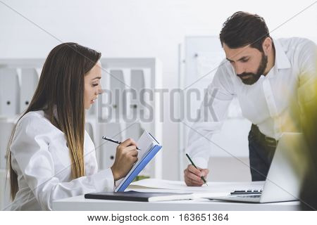 Bearded Man And A Woman Working Together