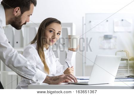 Bearded Man And A Woman At Work, Side View