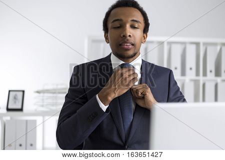 African American Man Adjusting His Tie