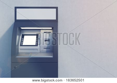 Close up of a black ATM machine standing near a concrete wall. Concept of monetary operations. 3d rendering. Mock up