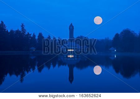 Mysterious  view of St. Hubertus Hunting Lodge in Dutch National Park  De Hoge Veluwe after sunset
