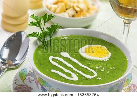 Cream soup with egg sour cream and wine on the table studio shot