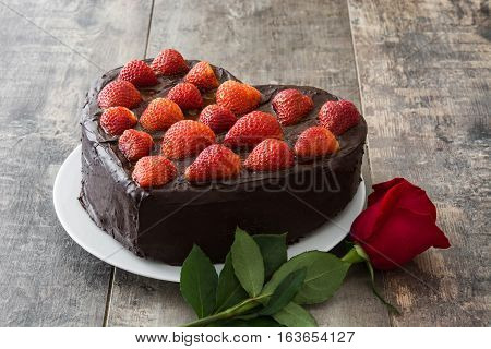Heart shaped cake for Valentine's Day or mother's day on wooden background