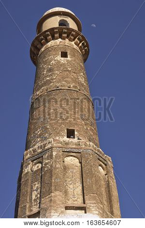 NAGAUR, RAJASTHAN, INDIA - FEBRUARY 14, 2008: Minaret of a historic mosque in the desert city of Nagaur in Rajasthan, India.