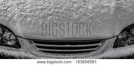 Front of the car close-up, radiator grille and headlights, automotive background