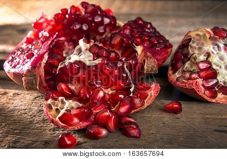 Pomegranat Grains. Pomegranate Close Up On Wooden Table