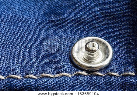Jeans Texture with Rivet and Thread Close Up. Blue Denim Fabric Background.